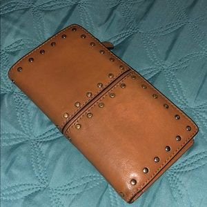 Michael Kors wallet, brown, with gold studs.